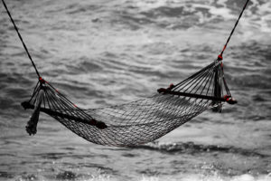 Image of string hammock suspended near water