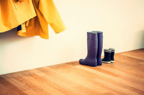 Image of gumboots and raincoats in hallway