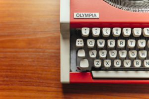 Partial image of orange vintage Olympia typewriter