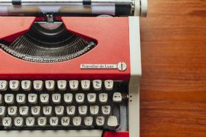 Closeup partial image of orange vintage Olympia typewriter