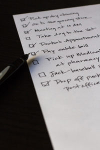 Closeup image of to-do list with boxes checked