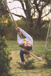 Image of girl on simple rope swing