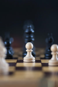 Image of chess pieces focused on white pawn