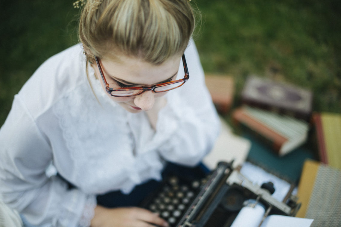Image of young woman with old typewriter