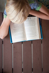 Image of boy reading book