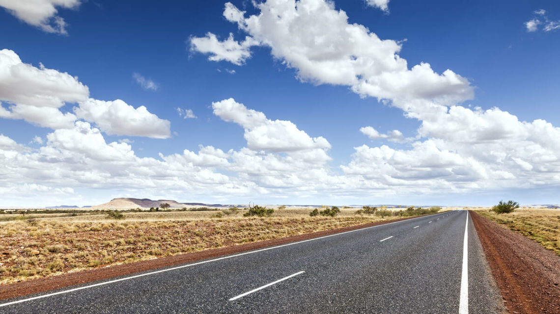 Image of road through flat dry landscape