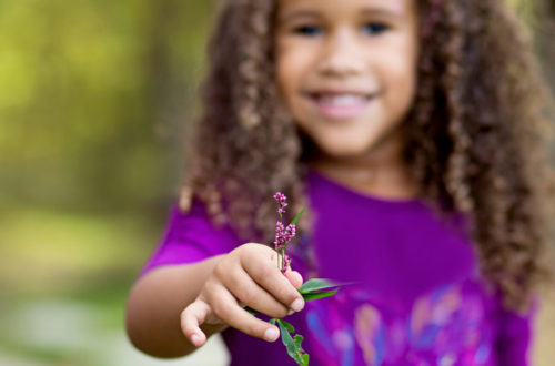 Image of girl with purple flower