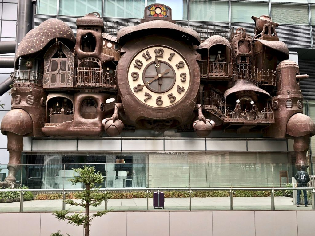 Giant Ghibli Clock in Tokyo, steampunk themed, copper & steel, 3 storeys high, by anime film director, Hayao Miyazaki
