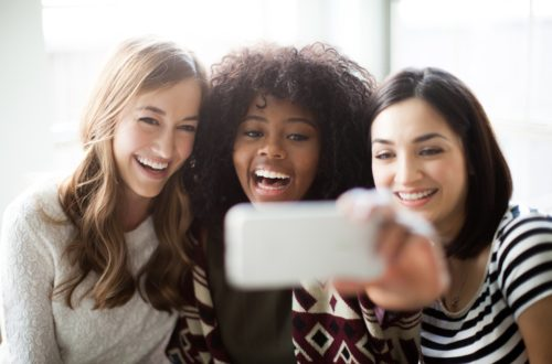 Three young women take a selfie