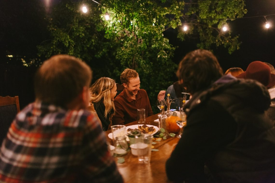 People sharing meal outdoors