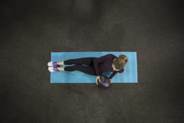 Overhead shot of woman exercising on mat