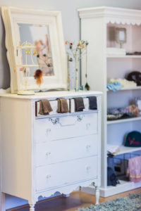 White painted chest of drawers with mirror, jewellery and socks