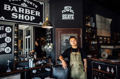 Old-style barber shop with young man leaning on chair