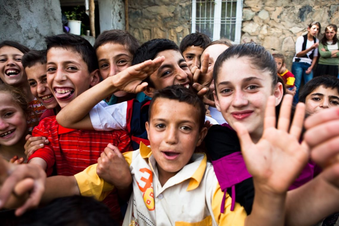 Group of happy Kurdish village kids